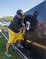 U.S. Navy Senior Chief Gunner's Mate Jaye Bell cleans the USS Oklahoma Memorial on Ford Island, Joint Base Pearl Harbor-Hickam, Hawaii, May 26, 2013 130526-N-WX059-019.jpg