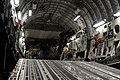 U.S. Soldiers with the 3rd Battalion, 160th Special Operations Aviation Regiment (SOAR) and Air Force loadmasters with the 15th Airlift Squadron prepare to unload a MH-60 Black Hawk helicopter from a C-17 110823-F-WA575-019.jpg