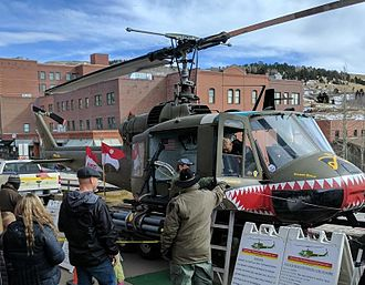 Bell UH-1 Iroquois variants - Bell UH-1M helicopter on a trailer being displayed in Cripple Creek, Colorado.