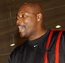 US Navy 030328-N-3503M-001 Former NBA player Jerome Kersey addresses a group of kids on the basketball court in the Naval Air Facility, Ranger Gym cropped.jpg