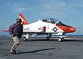 """US Navy 030817-N-8163B-501 Chief Aviation Boatswain's Mate Calvin J. Blocker, from Syracuse, New York, observes a T-45 """"Goshawk"""" assigned to Training Wing One, landing on the flight deck of USS Theodore Roosevelt (CVN 71).jpg"""