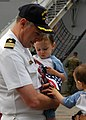 US Navy 050716-N-0050T-002 Commanding Officer, USS Pearl Harbor (LSD 52), Cmdr. Jonathan Harden, says goodbye to his loved ones before his ship departs Naval Station San Diego.jpg