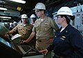 US Navy 050812-N-2383B-331 Chief of Naval Operations Adm. Mike Mullen is shown the navigational console by Program Manager, Cmdr. Jeff Riedel, left, and Ship's Navigator Lt.j.g. Rebecca Domzalski.jpg