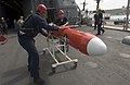 US Navy 060519-N-9851B-002 Aviation Support Equipment Technician 3rd Class Antonio Williams, left, and Storekeeper Seaman Brian Browning push a BQM-74E aerial target drone on the deck of amphibious dock landing ship USS Tortuga.jpg