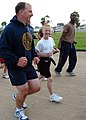 US Navy 060825-N-3560G-010 Equipment Operator 1st Class Joie McCarty assigned to Naval Mobile Construction Battalion Four (NMCB-4) and his son, keep pace during a family formation run.jpg