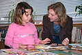 US Navy 061026-N-5271J-014 Jennifer Tonder (right), a teacher's aide for a 3rd-4th grade multi-age class, discusses the various books available from the Reading Is Fundamental (RIF) grant given to Sasebo Elementary School with.jpg