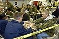 US Navy 061203-N-0318R-069 Navy Counselor 1st Class Timothy Wolfe attaches an identification bracelet to a U.S. Marine posing as an evacuee aboard amphibious assault ship USS Bataan (LHD 5).jpg