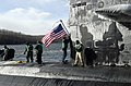 US Navy 070126-N-8467N-001 Sailors aboard Los Angeles-class fast attack submarine USS Philadelphia SSN 690 moor the boat to the pier and hoist the American flag upon return to Naval Submarine Base New London.jpg