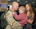 US Navy 070212-N-0916O-039 Construction Mechanic 2nd Class Jeremy Kroeger attached to Cargo Transfer Platoon One (CTP-1), greets his wife and son after returning from deployment.jpg