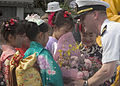 US Navy 070518-N-1251W-004 U.S. 7th Fleet Bandmaster, Lt. Walt Cline receives a bouquet of flowers from local school children after the band's performance prior during the 68th annual Shimoda Black Ship Festival.jpg