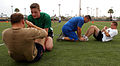 US Navy 070615-N-4163T-093 Sailors take turns completing a total of 60 sit-ups during the Naval Base San Diego and Navy Region Southwest Moral, Welfare and Recreation (MWR) 2nd Annual Backyard Fitness Challenge.jpg