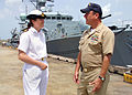 US Navy 070718-N-0857S-005 Lt. Lisa Pitman, deputy logistics officer aboard the British Royal Navy frigate HMS Portland (F 79) and Lt. Brian Bradshaw, operation officer for the Naval Support Activity New Orleans, discuss the sh.jpg