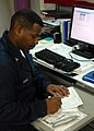 US Navy 081027-N-9900B-010 Storekeeper 2nd Class Christopher King logs supply tickets for inventory in the TR Mart.jpg