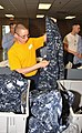 US Navy 090430-N-8848T-944 Seaman Recruit Christopher Santini, from Oregon City, Ore., examines his newly issued navy working uniform at Recruit Training Command.jpg