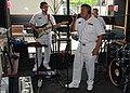 US Navy 090526-N-7375S-003 Chief Musician Frank Dominguez, Musician 1st Rory Cherry, and Musician 1st Class John Tuck perform a live broadcast on syndicated radio station WXFX 95.1.jpg