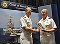 US Navy 090528-N-8273J-045 Chief of Naval Operations (CNO) Adm. Gary Roughead congratulates Capt. Aaron Cudnohafsky, commanding officer of the Pacific Missile Range Facility (PMRF), Kauai, Hawaii.jpg