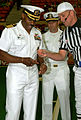 US Navy 090613-N-3750S-495 Capt. Dwight Shepherd, left, commander, Strategic Communications Wing 1, takes the coin for the coin toss from head referee Joe Pester to start the game.jpg