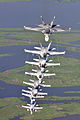 US Navy 090711-N-9712C-007 ight F-A-18 Hornets assigned the River Rattlers, Strike Fighter Squadron (VFA) 204, fly in a column formation over southern Louisiana's wetlands during a photo exercise.jpg