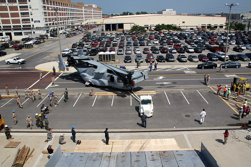US Navy 090811-N-5257L-001 Navy cargo personnel from Handling Battalion 11 of Jacksonville, Fla., participate in the loading of the Marine Corps MV-22 Osprey tilt-rotor aircraft at pier seven, Naval Station Norfolk, in Norfolk