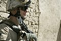 US Navy 090912-M-6159T-154 Hospital Corpsman 3rd Class Mike Shrage, assigned to Military Police Company, 5th Battalion, 10th Marine Regiment, maintains security during a joint patrol with Afghan national policemen.jpg