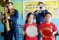 US Navy 090914-N-9689V-002 School children play instruments as the Pacific Fleet Band performs at Majuro Cooperative School during a Pacific Partnership 2009 community service project.jpg