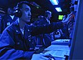 US Navy 100312-N-9950J-052 Operations Specialist 3rd Class Eric Tan stands watch in the combat information center aboard the forward-deployed amphibious assault ship USS Essex (LHD 2).jpg