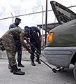 US Navy 100819-N-9643W-145 Senior Chief Master-at-Arms Charles Mobley instructs members of the Barbados Defense Force during a vehicle search drill during a Navy Criminal Investigative Service subject matter exchange for Southe.jpg