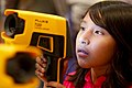 US Navy 101013-N-8863V-460 A fourth grade student from Arlanza Elementary School looks through a Navy thermal imager during the 11th annual Science.jpg