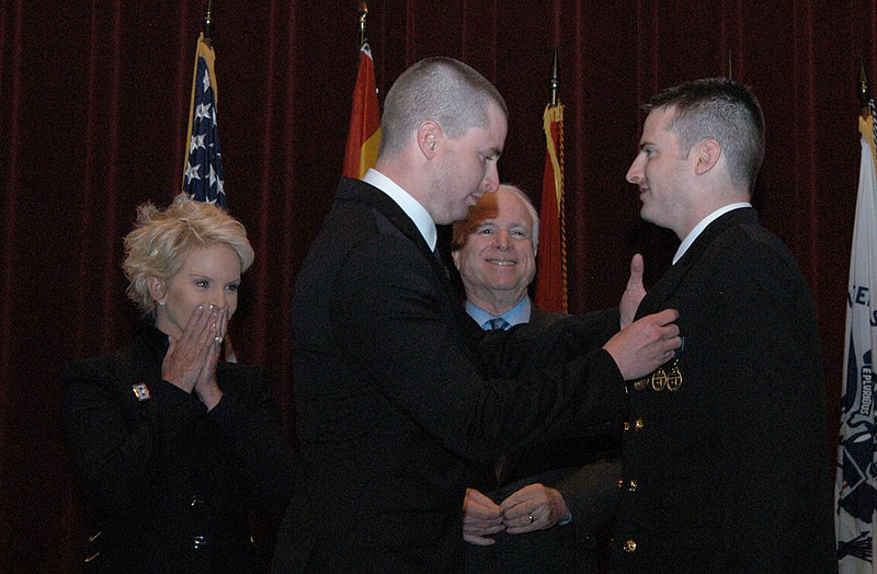 US Navy 110128-N-3303D-001 Sen. John McCain and his wife, Cindy, watch as their son, Jimmy McCain, pins aviator%27s wings on his brother, Ensign John.jpg