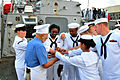 US Navy 110430-N-PS473-102 Sailors reach for a cookie from Art Ginsburg aboard SS Ross (DDG 71) during the taping of a Salute to the Troops segment.jpg