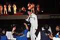 US Navy 110711-N-FP123-450 Musician 3rd Class Joshua Haney, assigned to the U.S. 7th Fleet Band, Orient Express, raps during a performance.jpg