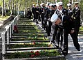 US Navy 110903-N-ON468-074 U.S. Navy Sailors place flowers at the graves of American merchant mariners who died supporting the Polar Convoys.jpg