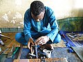 Un forgeron au travail au Niger.jpg