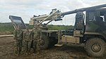 United States Army soldiers with Brutus 155mm wheeled self-propelled howitzer.jpg