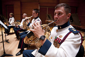 United States Coast Guard Band - A Coast Guard horn player wearing the concert ceremonial dress in 2011.