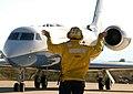 United States Navy aircraft handler directs C-37 Gulfstream V takeoff preparations at Souda Bay 021031-N-0780F-003.jpg