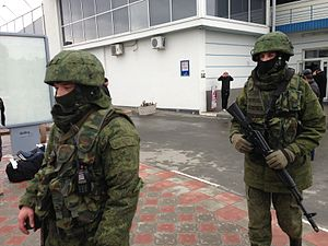 Russian military intervention in Ukraine (2014–present) - Russian troops with unmarked uniforms on patrol at Simferopol International Airport, 28 February 2014