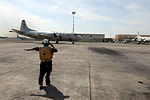VP-4 sailor gives the signal 130429-N-AL293-001.jpg