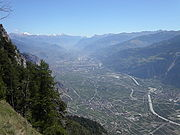 View looking down on the broad Rhone river valley running through the middle of the Valais