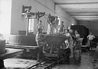 Vintage activities at Richon-le-Zion, Aug. 1939. Narrow guage trolleys carting away grape refuse from crusher LOC matpc.19781.jpg