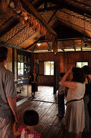 "Kadazan-Dusun - A group of people visiting ""The House of Skulls"" at Monsopiad Cultural Village in Penampang (near Kota Kinabalu), Sabah, Malaysia."