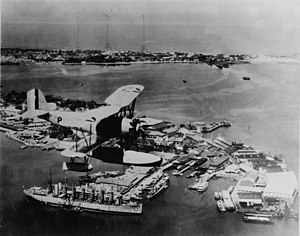 Philippine Navy - A U.S. Navy Vought O2U Corsair floatplane flying over the Cavite Navy Yard, c. 1930.