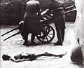 Warsaw Ghetto emaciated corpse to be collected on a cart 05.jpg