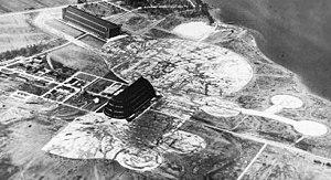 Weeksville Dirigible Hangar - A north-facing aerial view of the Weeksville Naval Air Station in 1944, showing the steel LTA hangar (center) and timber LTA hangar (top left).