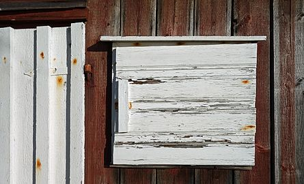 White wooden hatch with peeling paint.jpg