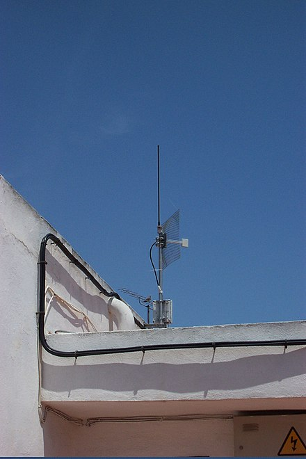 Parabolic dishes transmit and receive the radio waves only in particular directions and can give much greater range than omnidirection antennas Wifi point to point.jpg