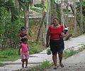 Woman with two children walking to catch a bus, Chaguaramal, Miranda State, Venezuela.jpg