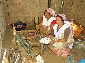 Chutia people - Women of Chutia tribe preparing pithas during Bihu/Bisu.