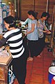 Working pregnant woman in kitchen Vietnam.jpg
