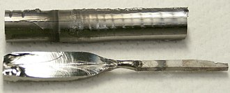 Yttrium borides - Two single crystals of YB66 grown by floating zone technique using (100) oriented seeds. In the top crystal, the seed (left from the black line) has same diameter as the crystal. In the bottom crystal (sliced), the seed is much thinner and is on the right